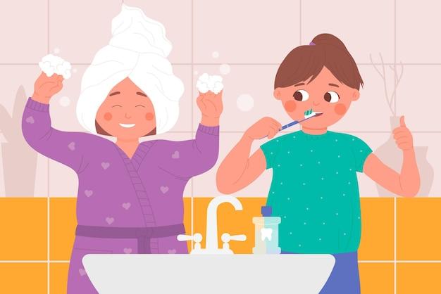 Дети играют в домашней ванной, дети чистят зубы, играя вместе во время гигиены