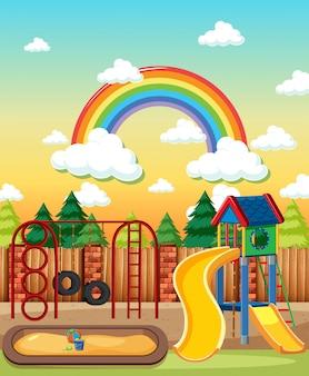 낮 만화 스타일의 하늘에 무지개가있는 공원에서 어린이 놀이터