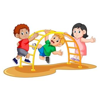 Kids playing on the climbing metal monkey bar in the backyard