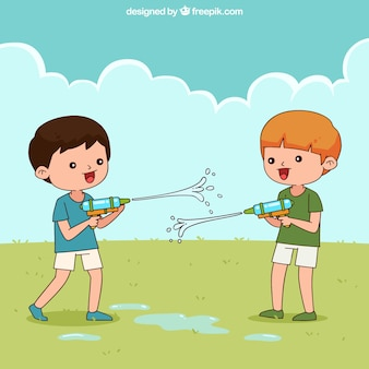 Kids playing in the garden with plastic water guns