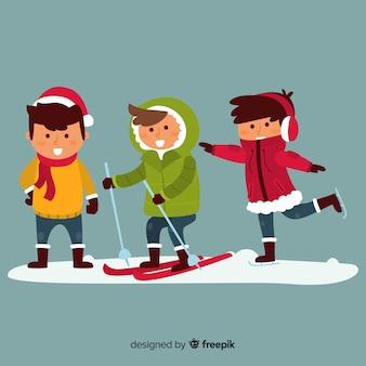 子供たちは雪で遊んでいる 無料ベクター