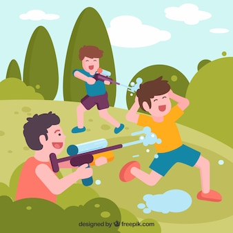 Kids playing in the park with plastic water guns