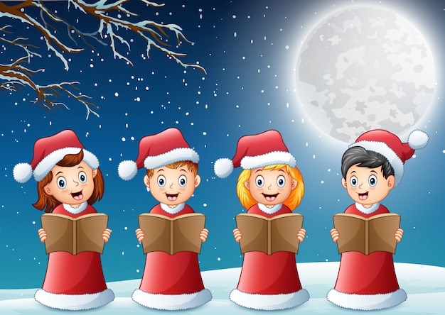 Kids in red santa costume singing christmas carols on winter