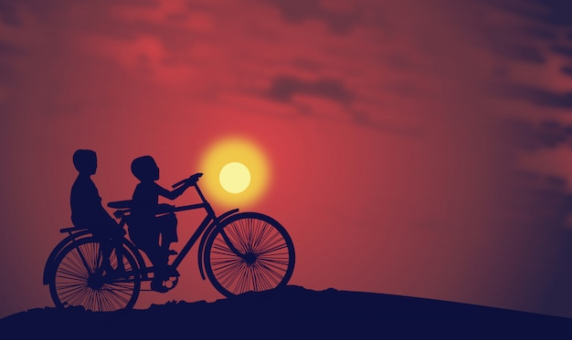 Kids riding a bike at sunset
