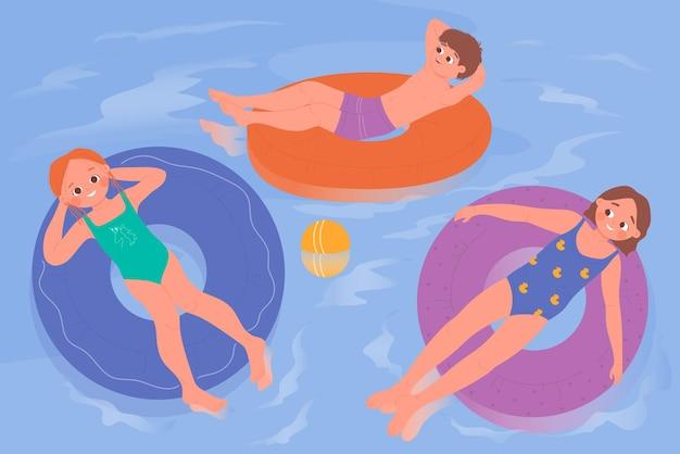 Kids swim in blue water of swimming pool children sunbathe tropical resort vacation