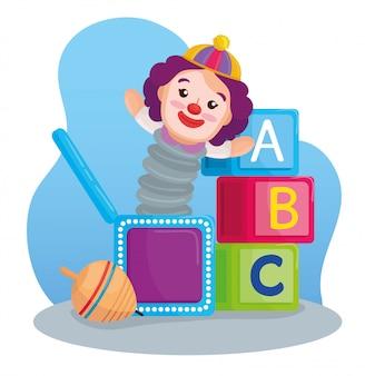 Детские игрушки, кубики алфавита с клоуном в коробке и вращающаяся игрушка