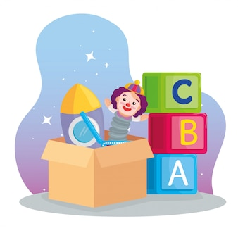 Kids toys, cubes alphabet and toys on the box carton