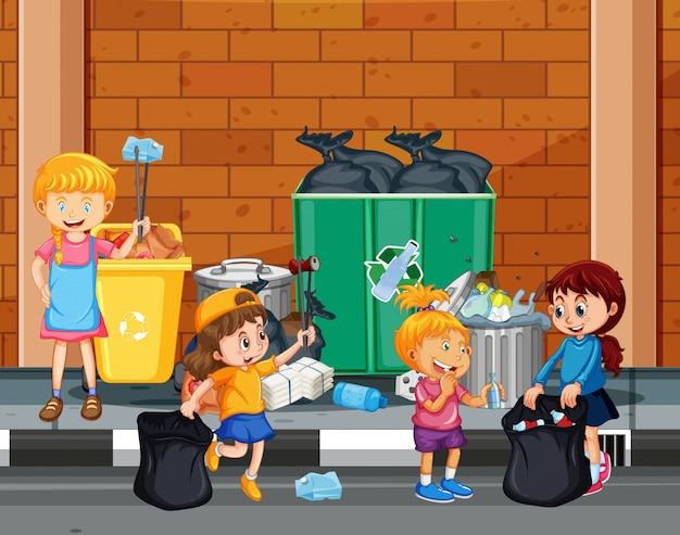 町を清掃しているボランティアの子供たち