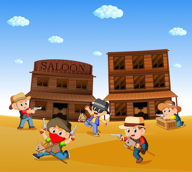 Kids wearing cowboy costume and playing with western town background