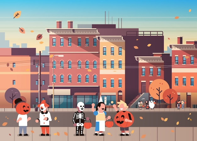 Kids wearing monsters costumes walking town holiday background