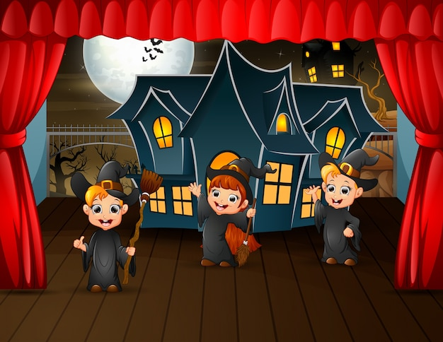 Kids in witch costume are performance on stage