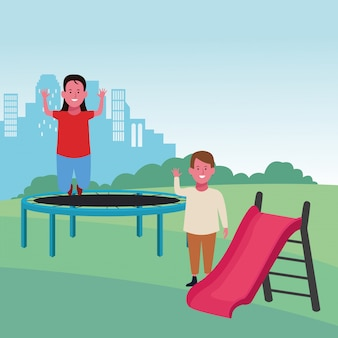 Kids zone, happy girl jumping trampoline and boy with slide playground