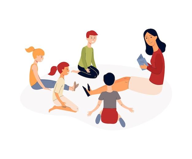 幼稚園教諭が子供教育プログラムで子供たちに本を読んでいる