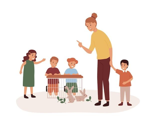 미취학 아동 그룹 평면 벡터 일러스트와 함께 유치원 교사. 애완 동물 돌보기 수업, 토끼와 놀아 라. 미취학 아동, 웃는 유치원생, 어린이 만화 캐릭터를 가진 여자.