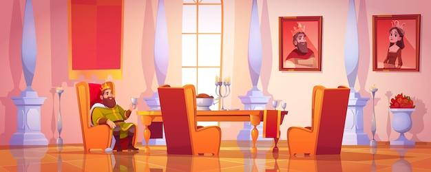 Король держит кубок, сидя за столом с едой Бесплатные векторы