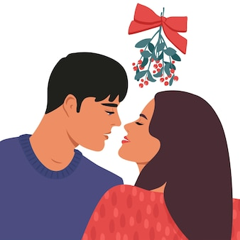 Kiss under the mistletoe. a pair of lovers.