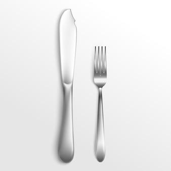 Кухонная и ресторанная посуда или посуда, посуда - набор столовых приборов из серебряной вилки и ножа, лежащих на столе, реалистичная иллюстрация на белом фоне.