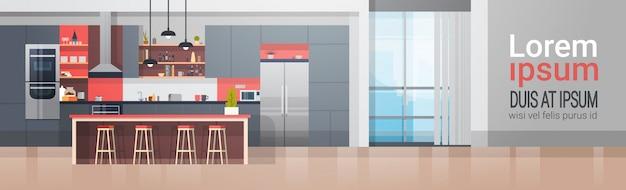 現代家具のカウンターおよび電気器具の横のバナーが付いている台所部屋の内部