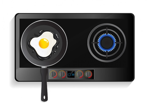 Kitchen stove with lit hob and fried egg on pan.