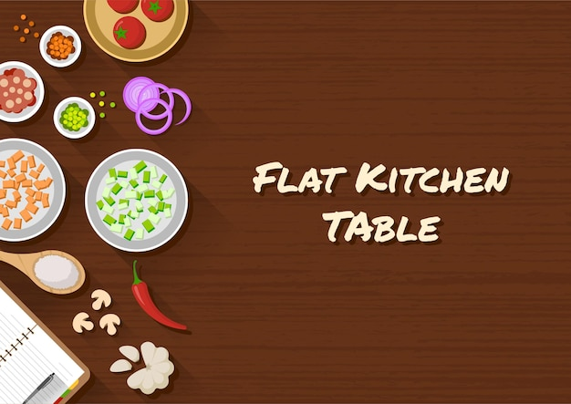 Kitchen table top view with various cooking ingredients