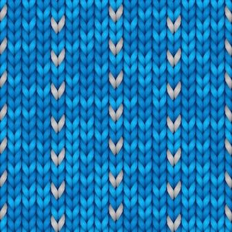 本文の空スペースでクリスマスの幾何学的な飾りをニットします。クリスマスのシームレスなパターン。ニットの冬の青い色のセーターのテクスチャです。図。