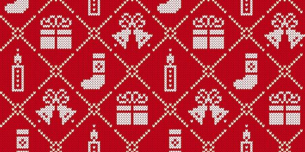 ニットのクリスマスプリント。ギフトボックス、キャンドル、ベル、ストッキングとクリスマスのシームレスなパターン。