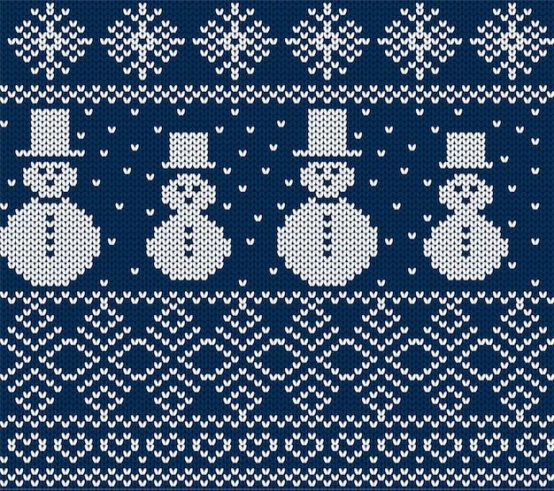 Вяжем рождество со снеговиками и снежинками. синий бесшовный фон.