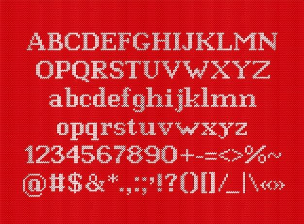 ニットフォント。シームレスなニットパターンのクリスマス書体。ベクター。文字番号記号と記号