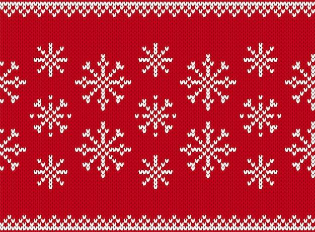ニットクリスマスシームレスパターン。クリスマスの背景。ニットセータープリント。お祝いの赤いテクスチャ