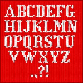 ニットアルファベットセット。フラットベクトル漫画イラスト。赤い布のテクスチャの背景に白い文字。