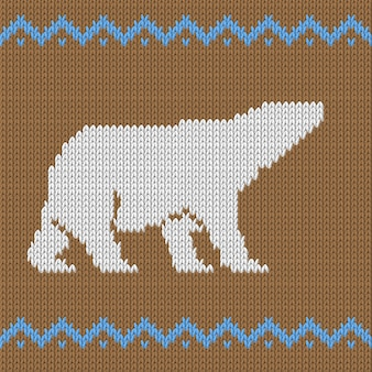 Knitted brown seamless pattern with polar bear with snow