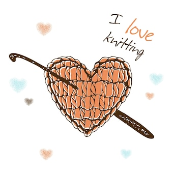 A knitted heart with a crochet hook