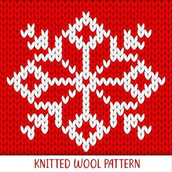 Вязаный узор из красных и белых снежинок