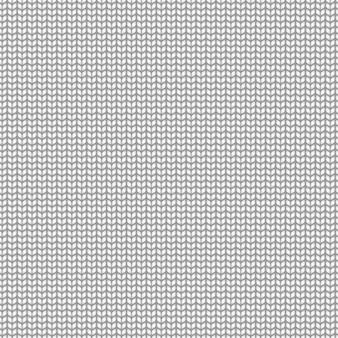 ニット柄。シームレスな白いセーターやスカーフのテクスチャ、漫画の手作りウールカーペットのテクスチャ