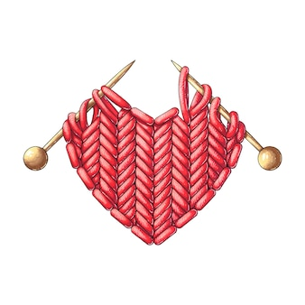 Knitted red heart with knitting needles
