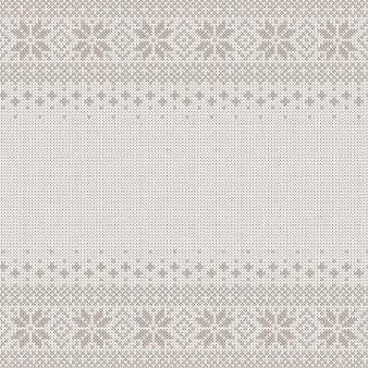 Knitted seamless background with copyspace. white and gray sweater pattern for christmas or winter design. traditional scandinavian ornament
