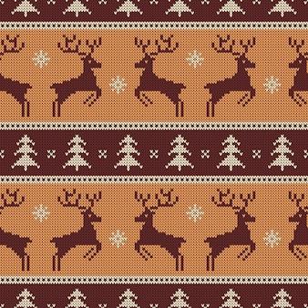 鹿とモミの木を使ったシームレスなニットパターン。