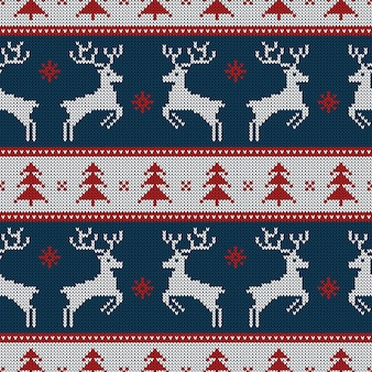 Knitted seamless pattern with deers and fir-trees.