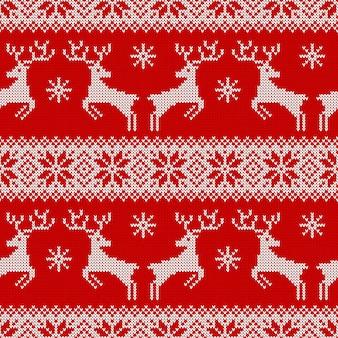 鹿の雪片とスカンジナビアの装飾が施されたニットのシームレスパターン