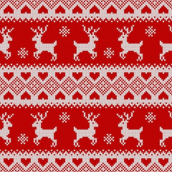 Вязаный фон с оленями. традиционный скандинавский узор для рождественского или зимнего дизайна. красный и белый орнамент свитера.