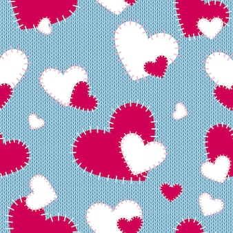 Knitted seamless pattern with sewn hearts.