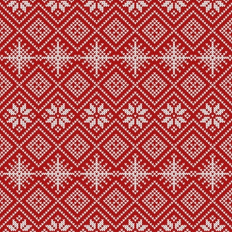 Knitted seamless pattern with snowflakes and traditional scandinavian ornament.