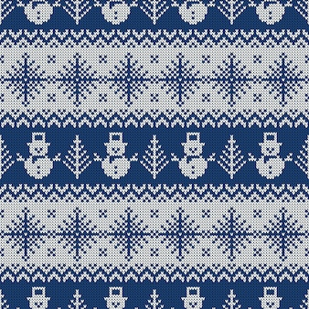 Knitted seamless pattern with snowmans and snowflakes.