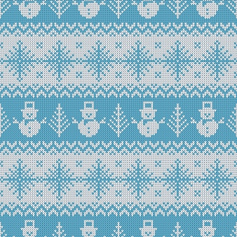 Knitted seamless pattern with snowmen and snowflakes.