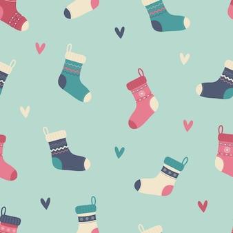 Вязаные носки и сердечки бесшовный фон