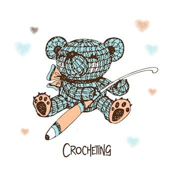 Knitted teddy bear with a crochet hook