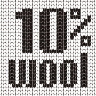Knitted text. 10 percent wool. in black and white colors.
