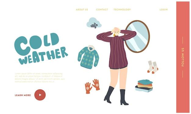 Вязаные вещи для шаблона посадочной страницы в холодную погоду. женский персонаж в теплой одежде примеряет вязаную шапку перед зеркалом для прогулок на открытом воздухе. модная одежда, одежда. линейные векторные иллюстрации