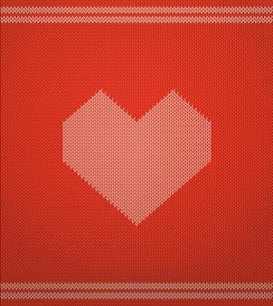 Вязаный векторный образец с красным сердцем.