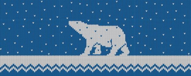 Вязаный зимний синий векторный фон с полярным медведем и снегом.